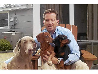 Rob with Dolly (Weimaraner), Franklin (red Dachshund) and Tyler (Black and Tan Dachshund).