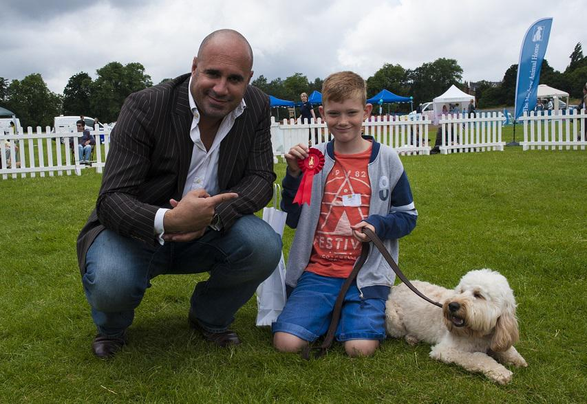 Photo Credit (Bonnie Baker) TV Vet Marc Abraham helping to judge last year. Tags: Hounds on the Heath rescue dog The Mayhew Animal Home