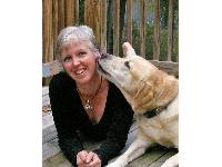 Trainer Denise Mazzole gets a kiss from her Labrador, Thor. Hear Denise in episode 149 of DogCast Radio.