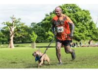 Runner and dog jogging