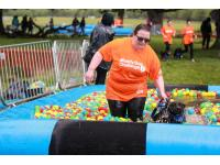 Joanna Scanlan and Millie taking on the Battersea Dogs & Cats Home Muddy Dog Challenge course.